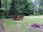 View of firepit in yard of the Tuckaway facing Kathan Lake