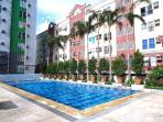 Swimming pool just in front of the condo unit