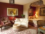 Sitting area and sleeping alcove. Top quality linens, luxurious queen bed.