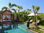 tropical garden with swimming pool