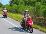 Motorbikes are available for rental to cruise the small island and visit other beaches