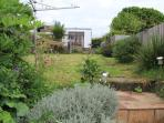 At the top of the steps a lovely garden with large decked area with views of the sea and monkestone