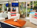Living Room has sliding glass door to covered terrance and view of garden pool