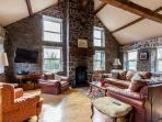 sitting room {12 windows) river and garden views. multi fuel stove. Sky TV - movies sports etc