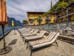 Our private sand lido and beachfront with views of Lake Como