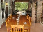 Covered veranda with 8 seat dining set.
