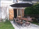 New for 2015 - terrace with table that seats 12 and sun umbrella