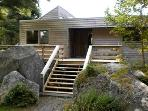 The Frances Louis House in Port Joli Nova Scotia is a delightful cedar home set in a fragrant woodland with a white...