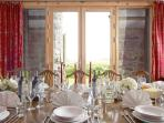 A view out from the South Tower formal Dining Room through the sandstone rent to the fields beyond