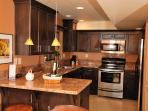 Western Suite full kitchen with granite countertops and stainless steel appliances.
