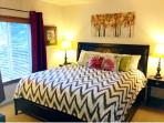 Sunny Master Bedroom with a King Bed, Large Closet, Flat Screen TV & DVD Player.