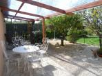 Covered Terrace, with seating, Gas BBQ and Herb Garden for Guests
