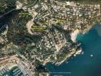 Air view of villa, club house, beach parking and beach.
