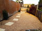 The sun trap terraced gardens, planted with cottagey Mediterranean style plants and herbs.