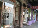 Magazine Street, 2 blocks away. Shops, restaurants, etc, stroll for miles