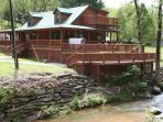 Have 2Br Master Suites. Sleeps 6 Hot Tub in (Bat Cave NC.) on river Also