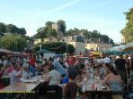 Tourists sampling the wares at the Monday evening market in Montignac's main square