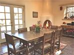 Dining With large Kiva fireplace