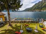 VIews from the balcony of gardens, sand lido, boat dock and Lake Como
