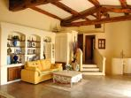 The true Provençal living room with beautiful rustic wooden beams
