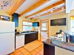 Kitchen is fully equipped for your cooking needs, door leads to hot tub patio and pool is just outside the kitchen...