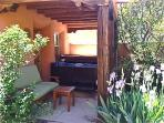 Private Hot tub in lush setting located in lovely Patio off the master bedroom