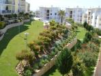 View from the balcony of the gardens and top swimming pool