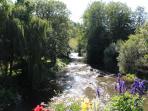 Looking along the river Sarthe at Saint-Léonard-des-Bois