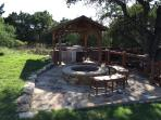 Outdoor Kitchen area - commercial grade grill with bar, fire pit and outdoor cooler