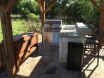 Outdoor kitchen with Bar seating - added in April 2015
