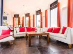 The lounge with leather sofas and wooden stove
