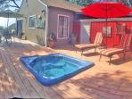 Our sunny hot tub deck at Harmony House.  Relax in complete privacy