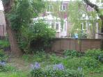 View of the house from the Green with Bluebells