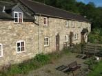 THE COTTAGE HAS AN ENCLOSED FRONT GARDEN WITH PICNIC BENCHES TO ENJOY THE VIEW WHILE YOU EAT
