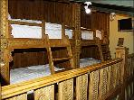 4 built in bunks in the loft feature wood detailing and are perfect for children.