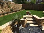 Private garden with outdoor seating and BBQ
