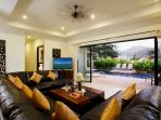 Open plan living and dining room opening onto large sundeck and private swimming pool