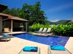 8 x 4 metre private swimming pool with integral Jacuzzi and feature sundeck