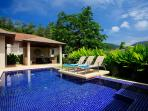 Inviting swimming pool with plenty of sun beds to soak up the sun