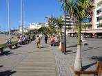 Beach of Los Cristianos with many shops and stores, restaurants and cafés