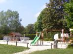 Childrens playground in the public recreation area, only 5 minutes walk away.