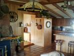 Though completely remodeled, it still retains the old fireplace & rustic charm of the old cabin