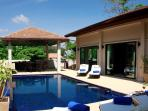 The large sun deck surrounding the private swimming pool
