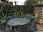 Large garden dining table seats 8.