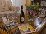 Pretty Albury Cottage lounge - complimentary bottle of wine included in your welcome hamper