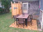 The patio has outdoor dining and a gas grill. There is an outdoor shower for your use as well ! - 13 Carol Lane West...