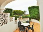 A large private entrance terrace overlooking onto the garden and pool, perfect for outdoor dining.