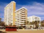 Apartment 91. wraps around the beach front and side of the top, ninth floor of the shorter, Ronda 3.