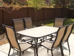 Patio table with seating for 6 people in the backyard