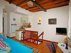 livingroom with bed coach, kitchen corner